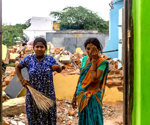 B. Venkatalakshmi and her daughter B. Kavita clean up after their home was bulldozed by the demolition crews